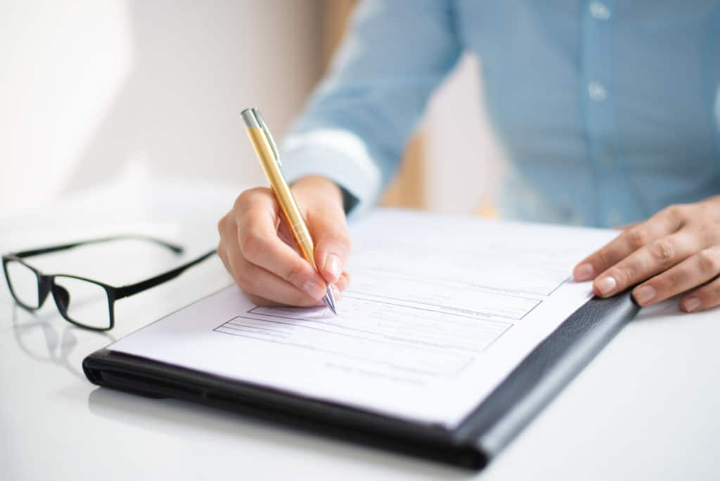 Woman signing divorce forms